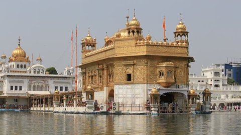 AMRITSAR, INDIA - SEPTEMBER 28, 2014: Unidentified Sikhs and indian people visiting the Golden Temple in Amritsar, Punjab, India. Sikh pilgrims travel from all over India to pray at this holy site.