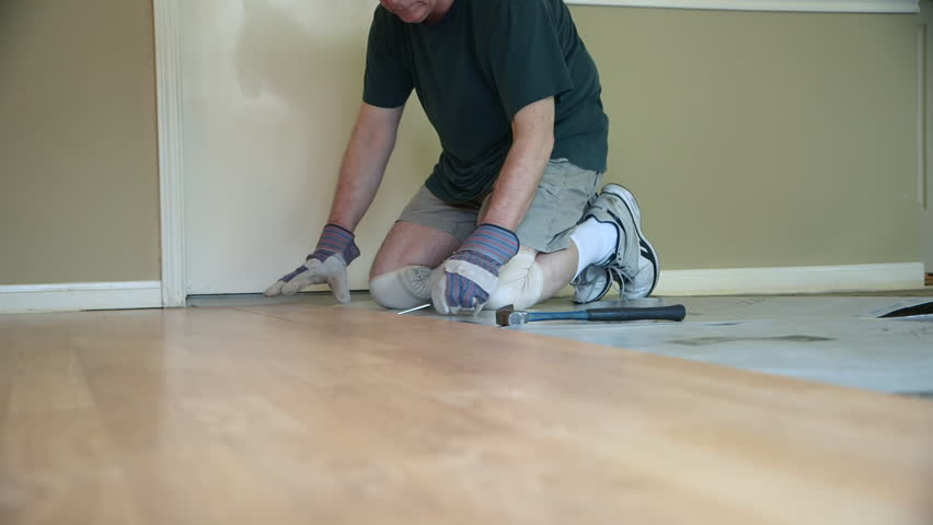 Stock Video Of A Worker Removing Old Laminate Flooring 9837335