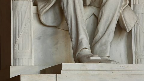 Washington, DC/United States - November 2012: Tilting shot of the Abraham Lincoln statue inside the Lincoln Memorial in Washington DC