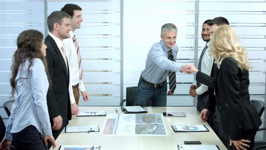 Successful meeting of business partners. Chief welcomes employees. Handshake of businessmen. | Shutterstock HD Video #9878885