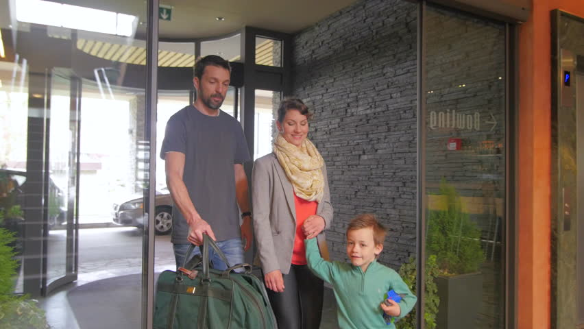 Family entering a hotel front