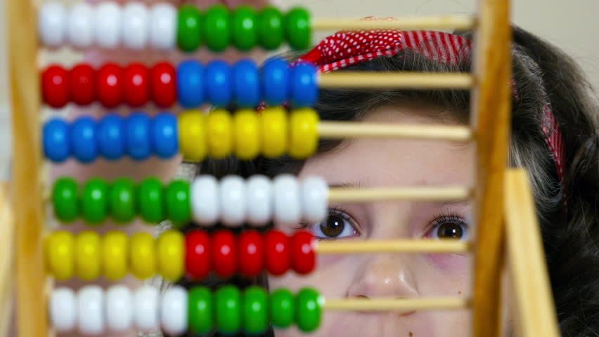 Cute little girl counting with abacus at home, close up | Shutterstock HD Video #9951395