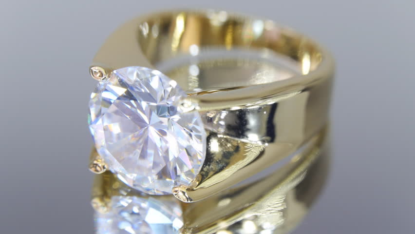 Rotating Gold Ring With A Diamond The Mirror Surface Closeup
