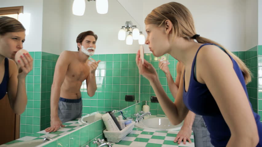 People beauty, wellness and body care, husband shaving and wife applying makeup in bathroom