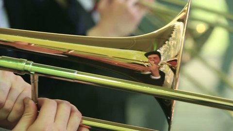 """MOSCOW, RUSSIA - MAY 09, 2015: trombones and trumpets. Close-up. Brass Band performing on the stage in the park. Festival marching bands in the city park """"Muzeon."""""""